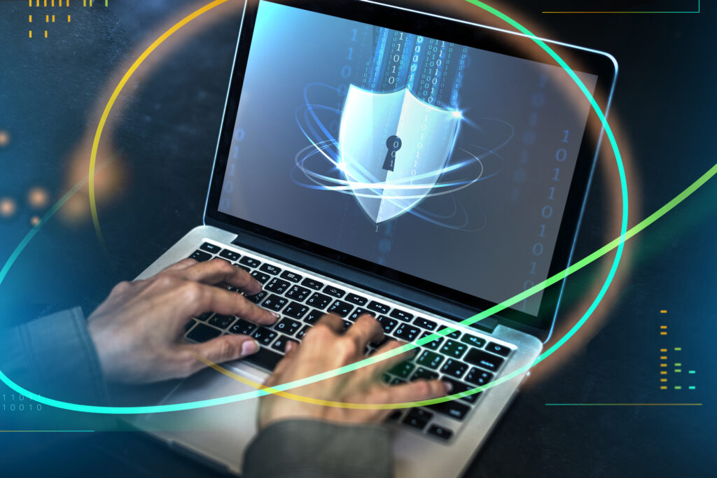 hacker cracking the security code on a laptop G2DQLKE